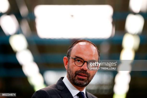 French Prime Minister Edouard Philippe is pictured during a visit to the French manufacturer SEB Moulinex's production plant in Mayenne western...