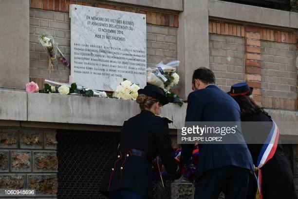 French Prime Minister Edouard Philippe lays a wreath in front of a commemorative plaque near the La Belle Equipe restaurant during a ceremony marking...