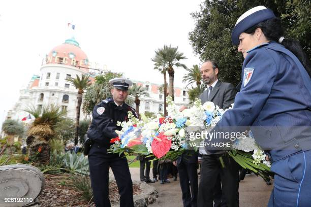 French Prime minister Edouard Philippe lays a wreath of flowers during a tribute to the victims of 2016 Bastille Day attack on March 2 2018 in the...