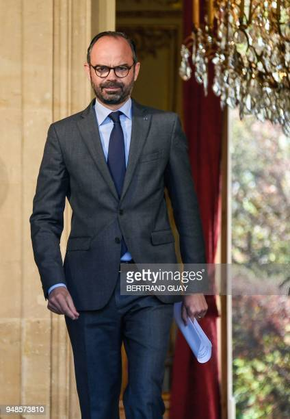 French Prime Minister Edouard Philippe leaves after a meeting gathering members of the government and local elected representatives of the French...