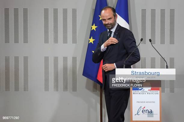 French Prime Minister Edouard Philippe leaves after a speech during a visit at the Ecole Nationale d'Administration on May 18, 2018 in Strasbourg,...