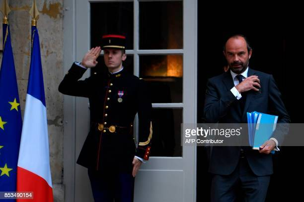 French Prime Minister Edouard Philippe leaves following a report by French economist Jean PisaniFerry on the Grand Investment Plan on September 25...