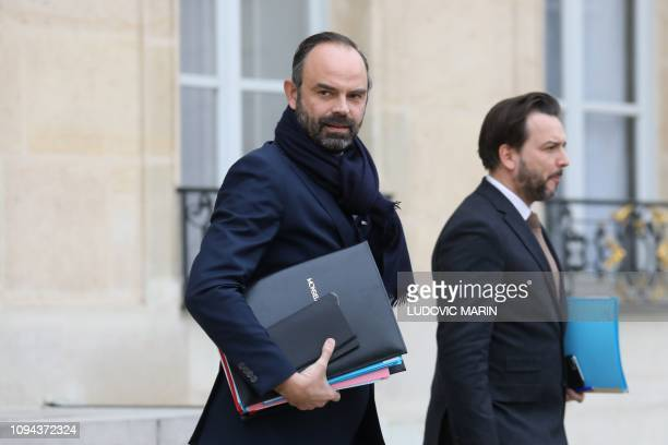 French Prime Minister Edouard Philippe leaves following the weekly cabinet meeting at the Elysee palace in Paris on February 6 2019