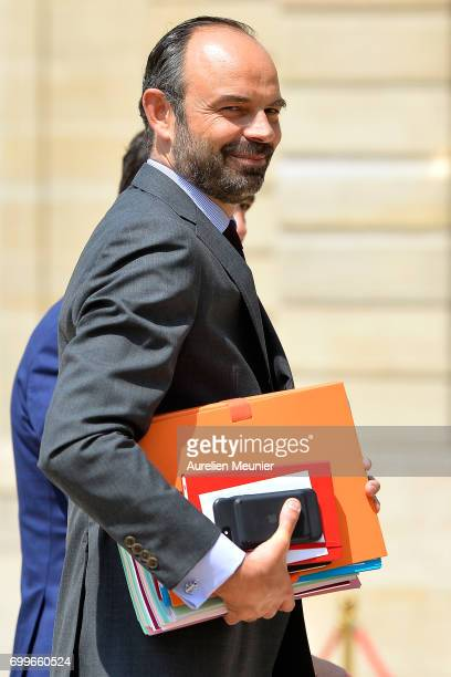 French Prime Minister Edouard Philippe leaves the Elysee Palace after the weekly cabinet meeting with French President Emmanuel Macron on June 22...