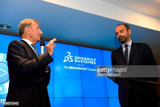 French Prime Minister Edouard Philippe listens to Dassault Systemes General Diector Bernard Charles during a visit at the headquarters of Dassault...