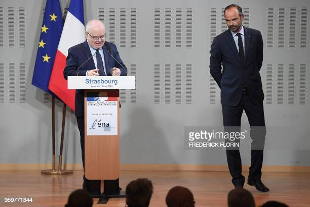French Prime Minister Edouard Philippe listens to ENA's director Patrick Gerard during a visit at the Ecole Nationale d'Administration on May 18,...