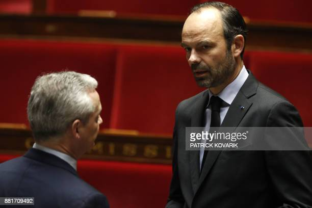 French Prime Minister Edouard Philippe listens to French Economy Minister Bruno Le Maire during a session of questions to the government at the...