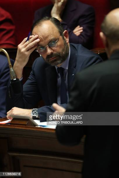 French Prime Minister Edouard Philippe listens to French Foreign Affairs Minister JeanYves Le Drian speaking during a session of questions to the...