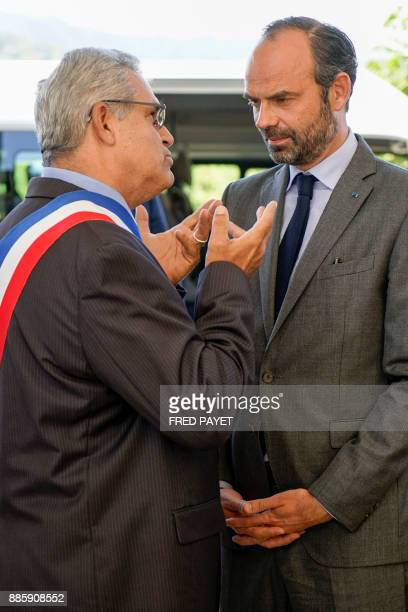French Prime Minister Edouard Philippe listens to MontDore mayor Eric Gay during the inauguration of a high school on December 5 2017 in MontDore /...