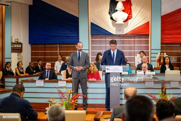 French Prime Minister Edouard Philippe listens to President of the Congress of New Caledonia Thierry Santa delivering a speech during a visit to the...