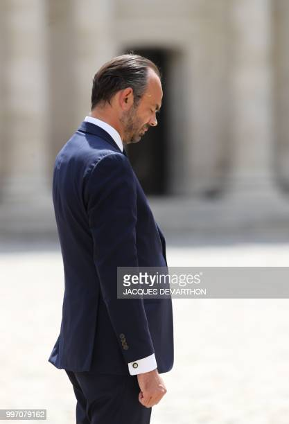 French Prime minister Edouard Philippe looks down as he takes part in a tribute ceremony to French filmmaker and writer Claude Lanzmann on July 12 at...