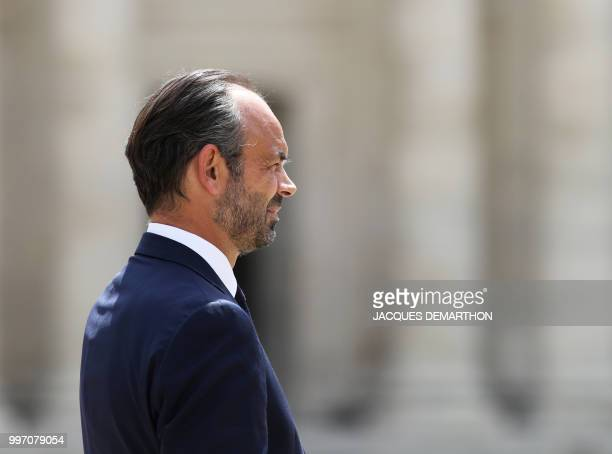 French Prime minister Edouard Philippe looks on as he takes part in a tribute ceremony to French filmmaker and writer Claude Lanzmann on July 12 at...