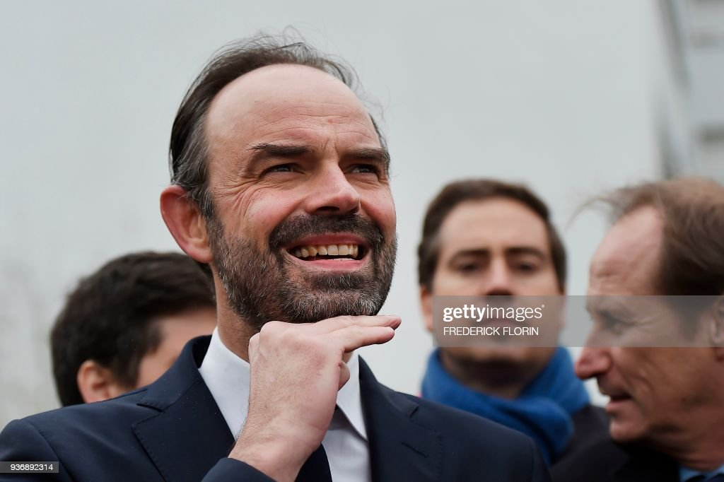 French Prime Minister Edouard Philippe looks on as he visits a ...