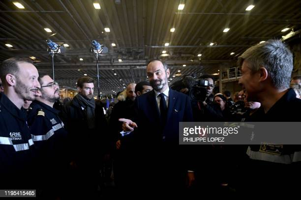 French Prime Minister Edouard Philippe meets crew members during his visit aboard the French aircraft carrier Charles de Gaulle at sea off the coast...
