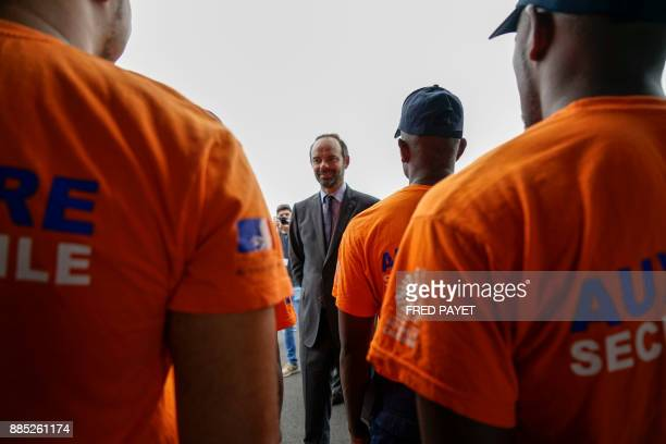 French Prime Minister Edouard Philippe meets members of the civil security during the inauguration of the KonePouembout rescue centre in Kone a city...