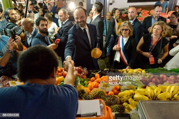 French Prime Minister Edouard Philippe meets people as he visits a market during his visit in Noumea in the French overseas territory of New...