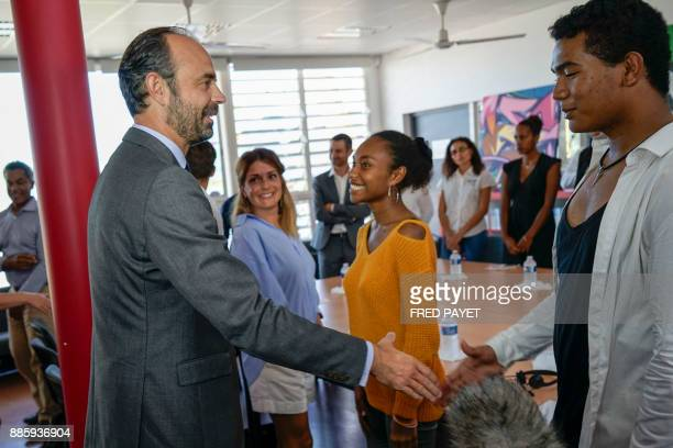 French Prime Minister Edouard Philippe meets with high school students during the inauguration of a high school in MontDore on December 5 2017 / AFP...