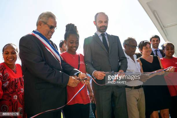 French Prime Minister Edouard Philippe MontDore mayor Eric Gay and French Overseas Minister Annick Girardin cut the ribbon during the inauguration of...
