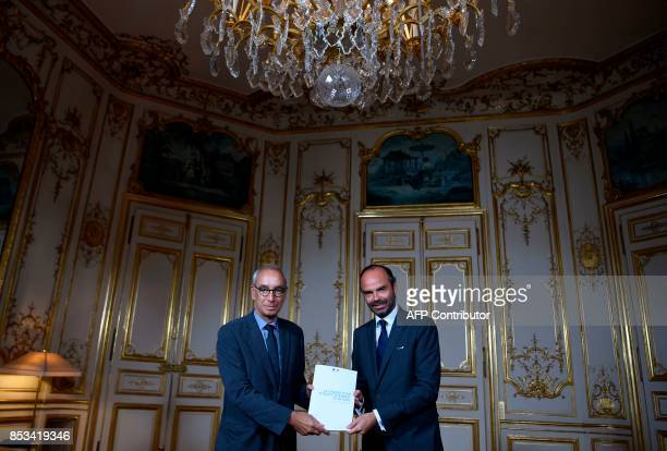 French Prime Minister Edouard Philippe poses with French economist Jean PisaniFerry following a report by PisaniFerry on the Grand Investment Plan on...
