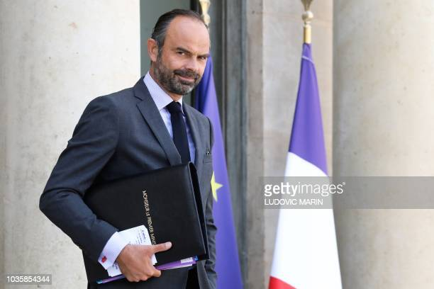 French Prime Minister Edouard Philippe reacts as he leaves the Elysee palace after the weekly cabinet meeting on September 19 2018 in Paris