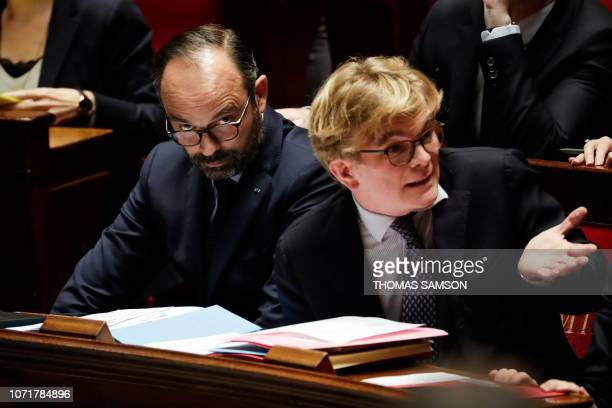 French Prime Minister Edouard Philippe reacts as he sits next to French Junior Minister attached to the Prime Minister in charge of Relations with...