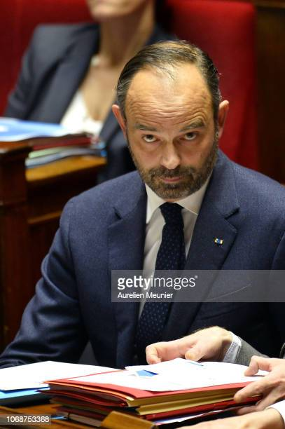 French Prime Minister Edouard Philippe reacts as Ministers answer deputies during the weekly session of questions to the government at Assemblee...