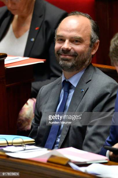 French Prime Minister Edouard Philippe reacts as Ministers answer deputies questions during the weekly session of questions to the government at...
