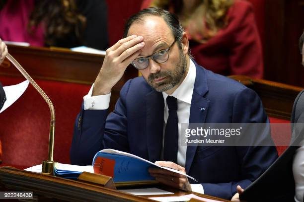 French Prime Minister Edouard Philippe reacts as Ministers answer deputies questions during a session of questions to the government at Assemblee...