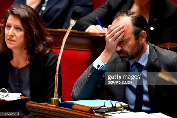 TOPSHOT French Prime Minister Edouard Philippe reacts during a session of questions to the government on February 13 2018 at the French National...