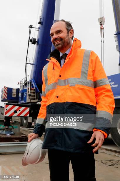 French Prime Minister Edouard Philippe reacts during a visit to the drilling site of the future Metro Line 15 South of the Grand Paris Express on...