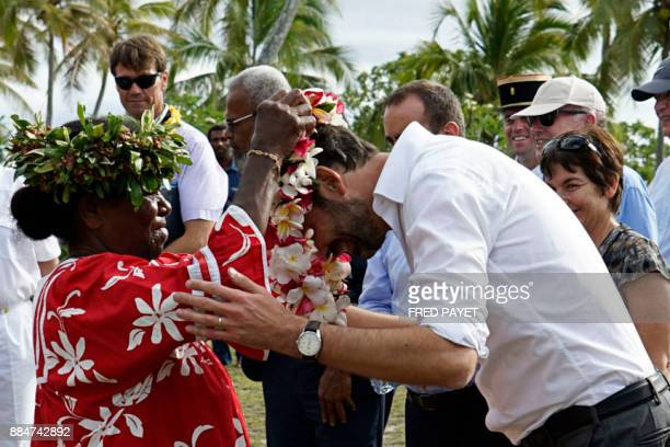 French Prime Minister Edouard Philippe receives a flower neklace during a welcoming ceremony at the Tiga chiefdom on Tiga island in the archipelago...