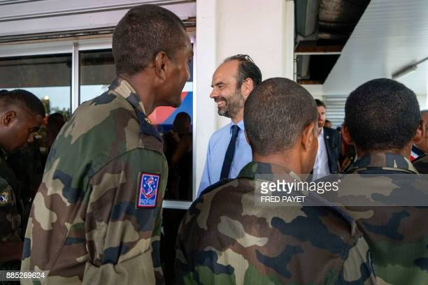 French Prime Minister Edouard Philippe reviews troops during a visit of a military base in Grande Terre island on December 4 2017 in Koumac as part...