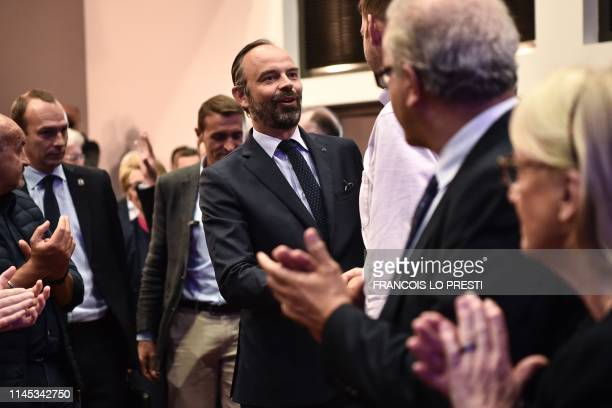 French Prime Minister Edouard Philippe shakes hands as he arrives for a La Republique en Marche political meeting ahead of the upcoming European...