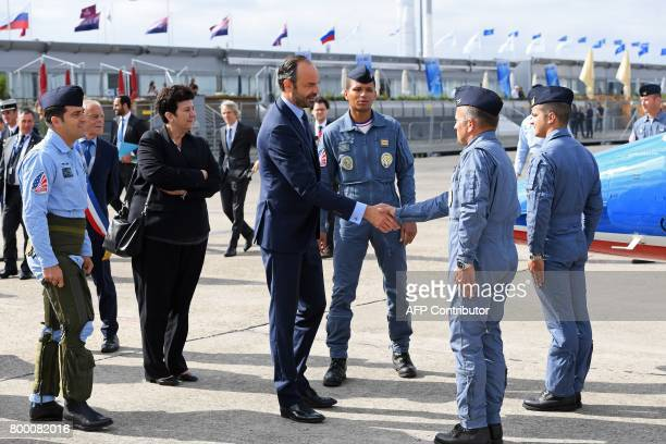 French Prime Minister Edouard Philippe shakes hands with pilots from the Patrouille de France during a visit to the International Paris Air Show in...