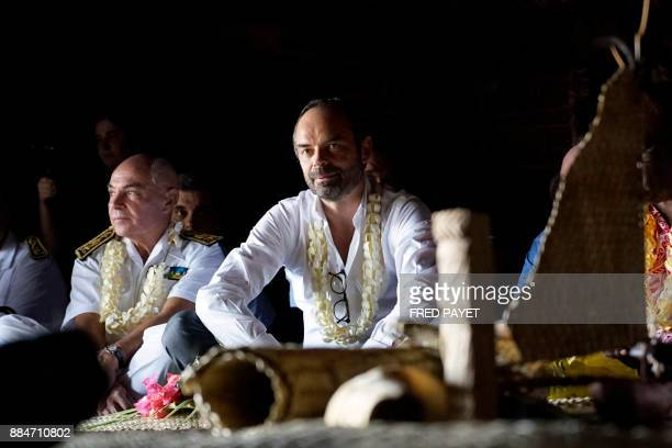 French Prime Minister Edouard Philippe sits in the Grande Case during a welcoming ceremony in the district of Wetr in Hnatalo on the Lifou Island on...