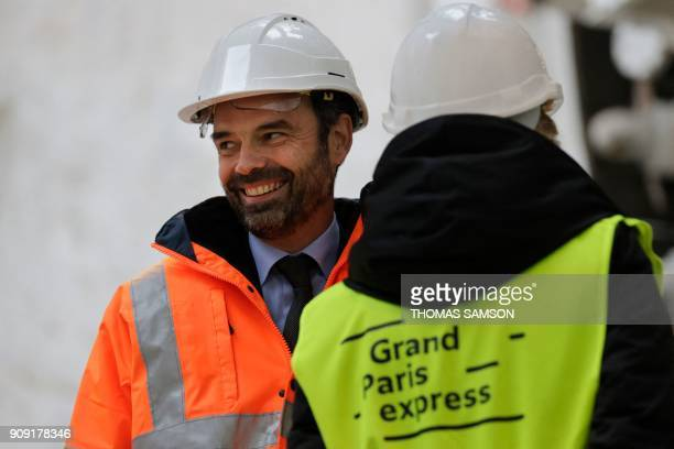 French Prime Minister Edouard Philippe smiles during a visit to the drilling site of the future Metro Line 15 South of the Grand Paris Express on...
