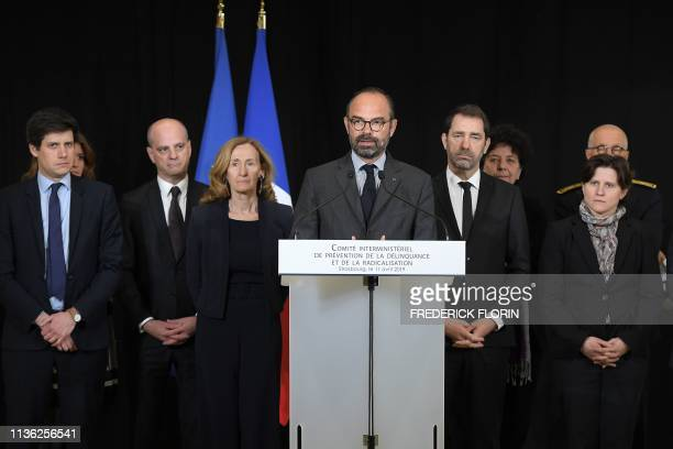 French Prime Minister Edouard Philippe speaks as ministers stand behind him at the closure of an interministerial committee on delinquency and...
