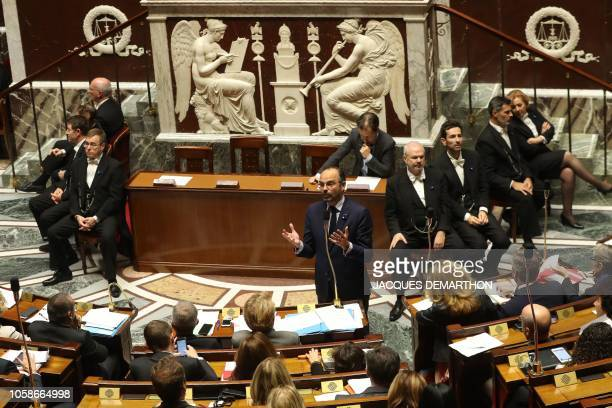 French Prime Minister Edouard Philippe speaks during a session of questions to the Government at the French National Assembly in Paris on November 7...