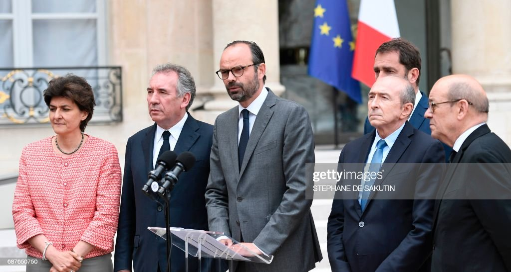 French Prime Minister Edouard Philippe (C) speaks flanked by (from L) French Minister of the Armed Forces Sylvie Goulard, French Minister of Justice Francois Bayrou, French Minister of State for Relations with Parliament and government spokesperson Christophe Castaner, French Minister of the Interior Gerard Collomb and French Minister of Europe and Foreign Affairs Jean-Yves Le Drian after the weekly cabinet meeting on May 24, 2017 at the Elysee presidential Palace in Paris. /