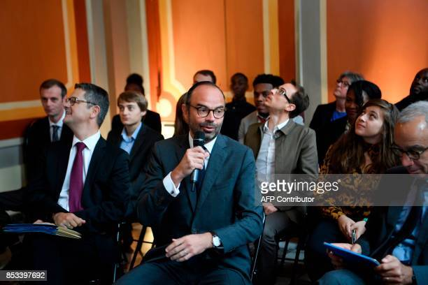 French Prime Minister Edouard Philippe speaks flanked by Prime Minister's Adviser for Social Employment and Formation speaks during a report on the...