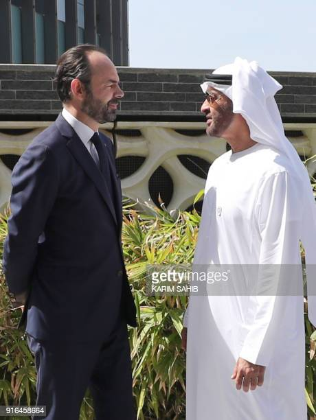 French Prime Minister Edouard Philippe speaks to Abu Dhabi's Crown Prince Mohammed bin Zayed AlNahyan during a visit to the Gulf emirate's Louvre...