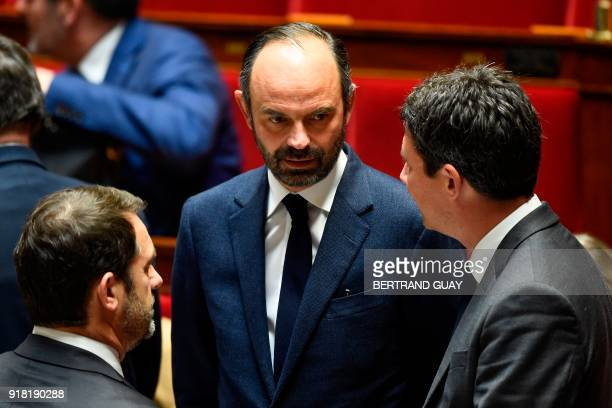 French Prime Minister Edouard Philippe speaks to French Government Spokesperson Benjamin Griveaux and French Junior Minister for the Relations with...
