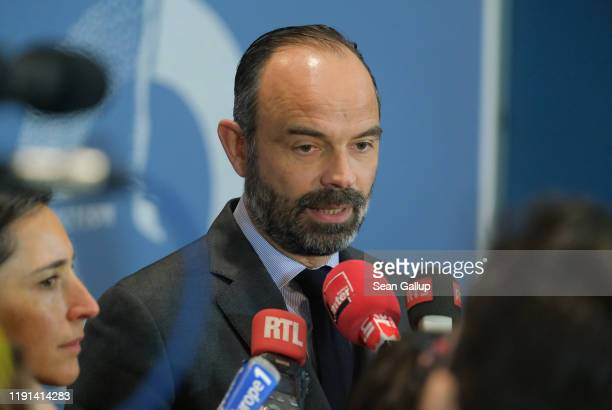 French Prime Minister Edouard Philippe speaks to the media as he attends the opening of the UNFCCC COP25 climate conference on December 2, 2019 in...