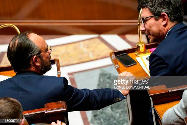 French Prime Minister Edouard Philippe speaks with French Junior Minister and Government's spokesperson Benjamin Griveaux during a session of...