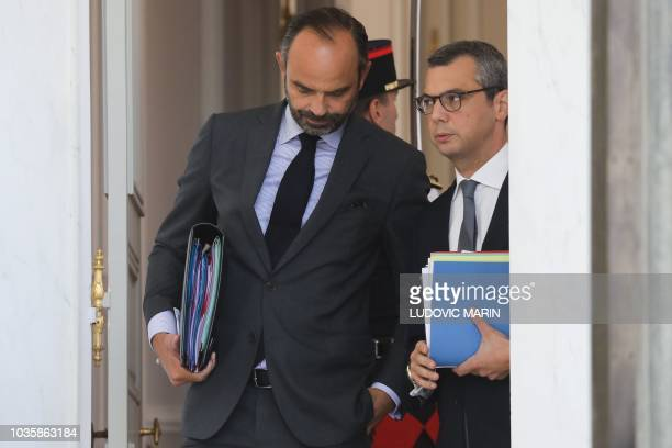 French Prime Minister Edouard Philippe speaks with Presidency general secretary Alexis Kohler as they leave the Elysee palace after the weekly...