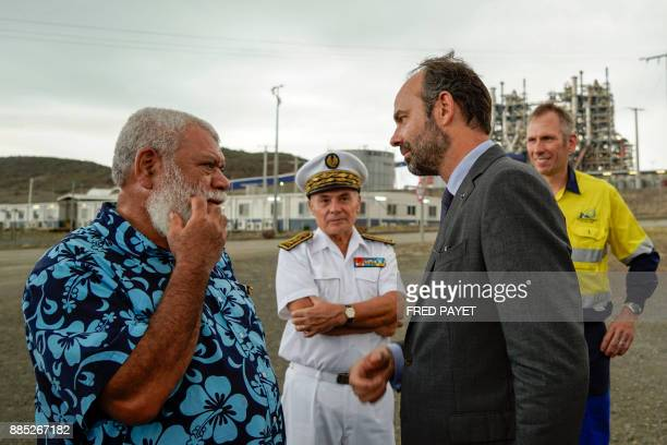 French Prime Minister Edouard Philippe speaks with president of the North Province of New Caledonia Paul Neaoutyine during his visit of the nickel...