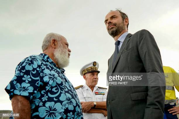 French Prime Minister Edouard Philippe speaks with president of the North Province of New Caledonia Paul Neaout during his visit of the nickel mining...
