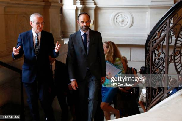 French Prime Minister Edouard Philippe speaks with the first President of the French Court of Cassation Bertrand Louvel as he arrives at the Tribunal...