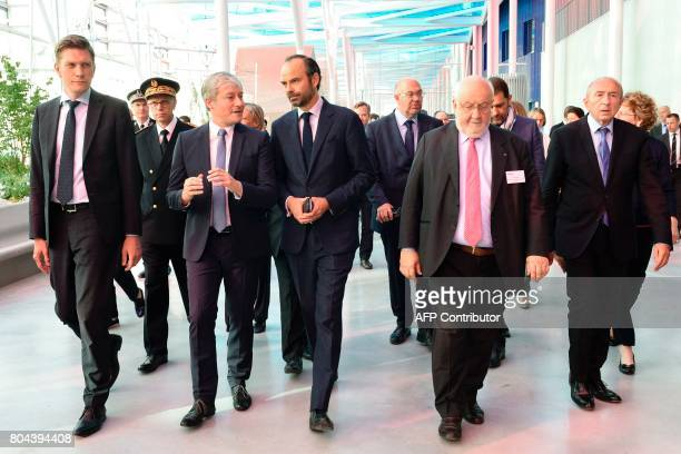 French Prime Minister Edouard Philippe speaks with the mayor of Nancy Laurent Henart flanked by French Interior Minister Gerard Collomb and President...