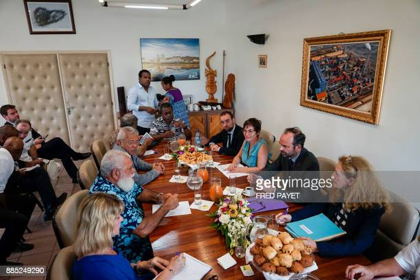 French Prime Minister Edouard Philippe speaks with the president of president of the North Province of New Caledonia Paul Neaoutyine prior to a...